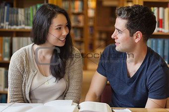 Two people studying in a library