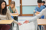 Two students cheating in the classroom