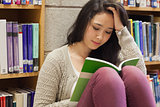 Stressed student reading a book