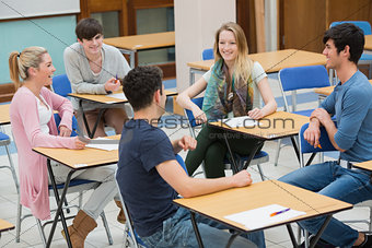 Chatting students in the classroom