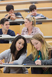 Students learning and talking in a lecture hall