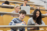 Students listening and taking notes in a lecture