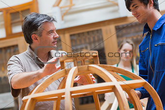 Explaining teacher in a woodwork class