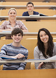 Happy students sitting in a lecture hall