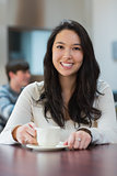 Smiling student in a coffee shop