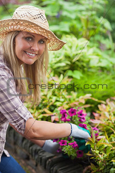 A woman is working in the garden