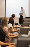 Teacher standing in front of projection screen