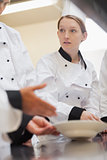 Trainee chef listening to teacher