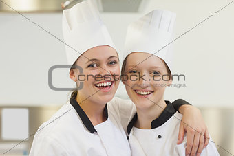 Two chefs smiling
