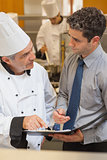 Chef and waiter having a discussion