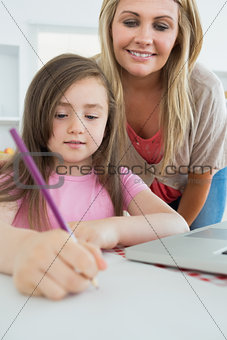 Mummy and her daughter coloring
