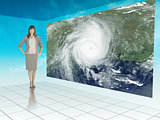 Businesswoman standing next to futuristic screen showing weather
