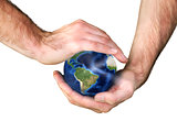 Male hands holding the earth