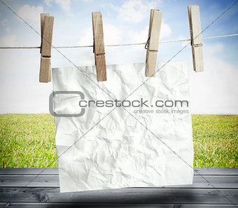 White crumpled paper hung on a laundry line
