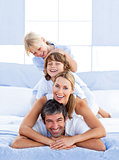 Family piled on top of dad
