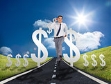 Businessman running on a road with dollar signs