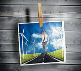 Photo of businessman running on a road hung on a line
