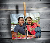 Ripped photo of couple hung with a peg