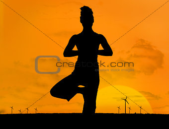 Silhouette of woman doing yoga outdoors