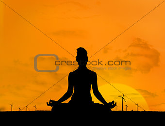 Silhouette of woman doing yoga