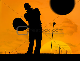 Man playing golf under the sunset