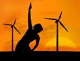 Woman practicing yoga under sunset