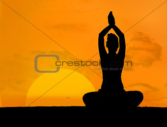 Calm silhouette of woman doing yoga