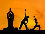 Silhouette of women doing yoga