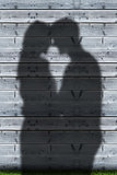 Shadows of couple embracing
