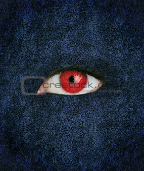 Red eye over blue texture