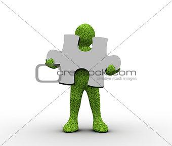 Green character holding a jigsaw piece
