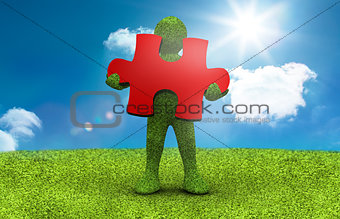 Green character holding a red jigsaw piece