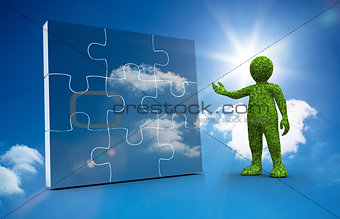 Green character presenting a jigsaw