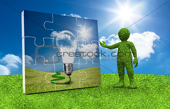 Green character presenting a jigsaw with light bulb inside