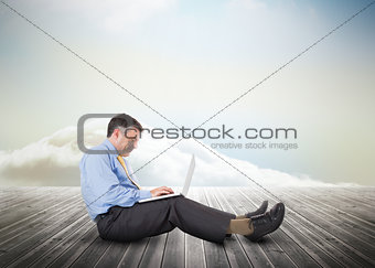 Mature businessman over wooden boards leading out to the horizon