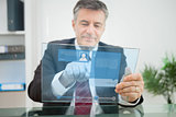 Businessman using futuristic touchscreen to view social media profile
