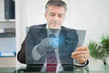 Businessman using futuristic touchscreen to view data