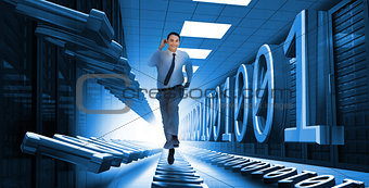 Businessman sprinting through data center