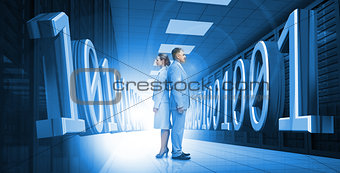 Business people standing back to back with 3d binary code in blue