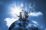 Businessman sitting on top of the world with data server