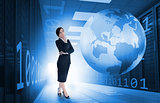 Businesswoman standing in data center with earth and binary code graphics