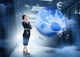 Businesswoman standing in data center with earth and currency graphics