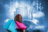 Girl with shopping bags looking at  data server on top of earth
