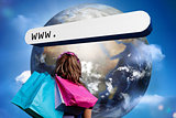 Girl with shopping bags looking at address bar with large earth