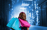 Girl with shopping bags looking at falling matrix