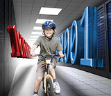 Happy boy on a bike in data center