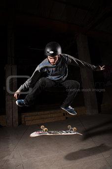 Skater doing kickflip trick