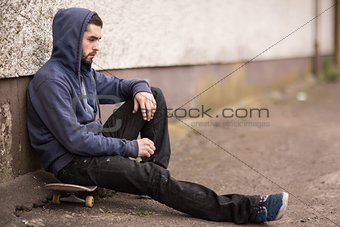 Skater taking a break outside the skate park