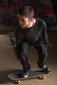 Skater bending his knees for balance