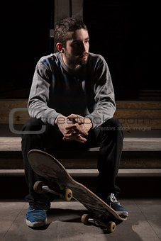 Skater sitting on steps in the skate park
